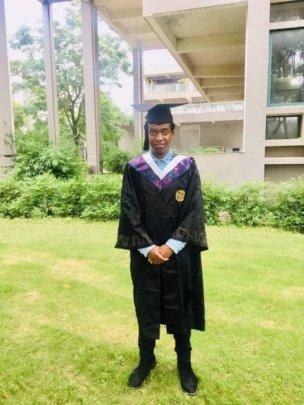 Phillip graduating in China
