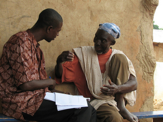 IPA enumerator Joseph Banyan interviewing a farmer in Tamale