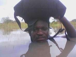 Hakeem, braving floods to make an insurance payout
