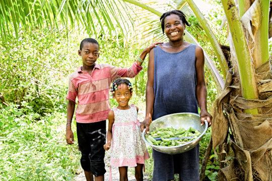 Wilda and her children in the garden