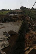 Israeli Army bulldozer ripping Peace Road apart