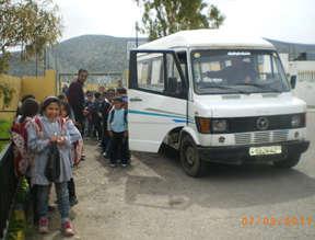 Their schoolbus: vintage minivan,4 trips each way