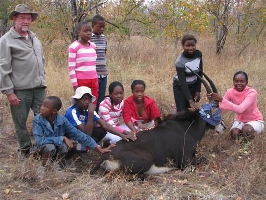 Children with a Sable Antelope