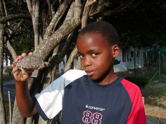 Thabang with a Leopard Tortoise