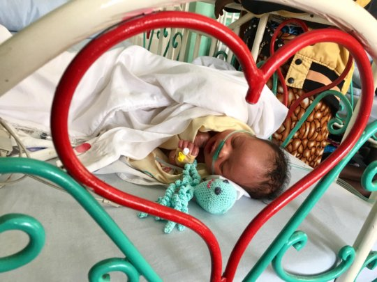 newborn baby on oxygen treated for pneumonia