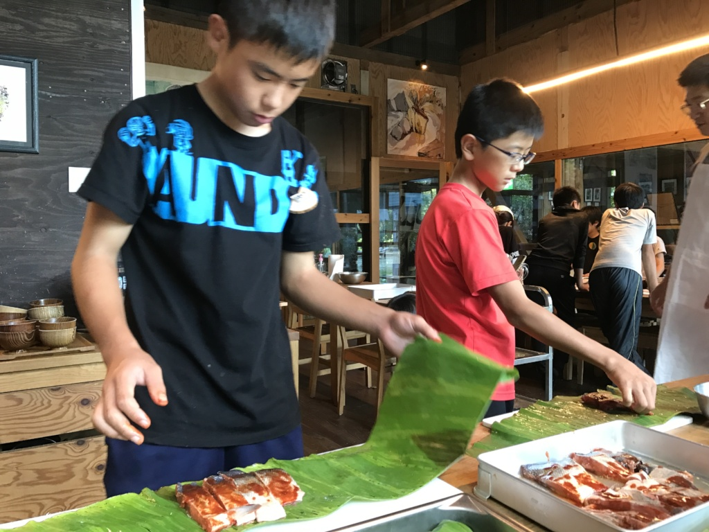 wrapping ingredients with banana leaves