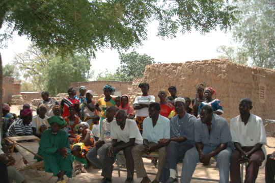 Meeting with men and women in the village of Fina