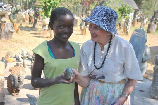 Edone with a young student in Zimbabwe