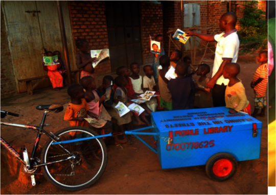 Books by bike - the library arrives at a village.