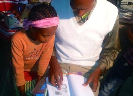 Father and daughter in an Ethiopian library.