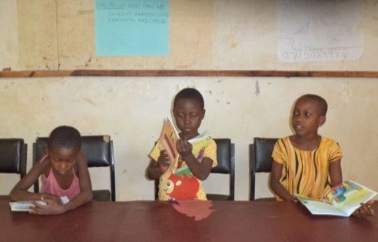 Reading activity, Dzitsoni Public Library, Kenya.