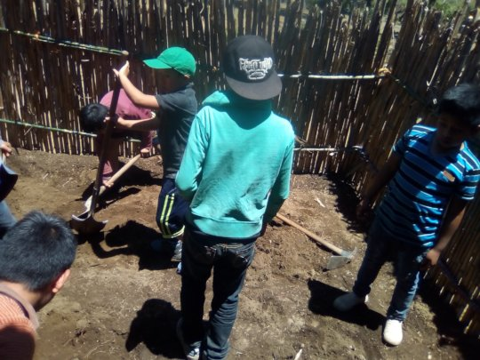Grade 5  students helping to construct garden