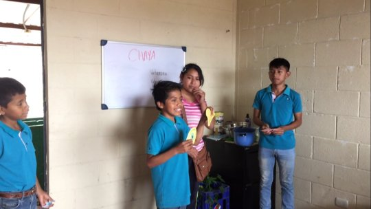 Students teaching nutrition classes to moms