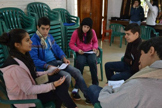 Aymara discussing with fellow leaders