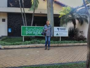 Safira in front of the Fundacion Paraguaya office
