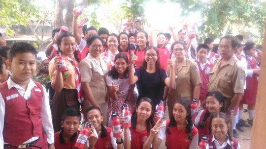 Students Receiving their Bottles