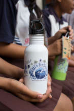 Our white bottle with a student-designed graphic