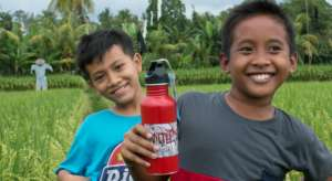 2 more students with their new water bottles
