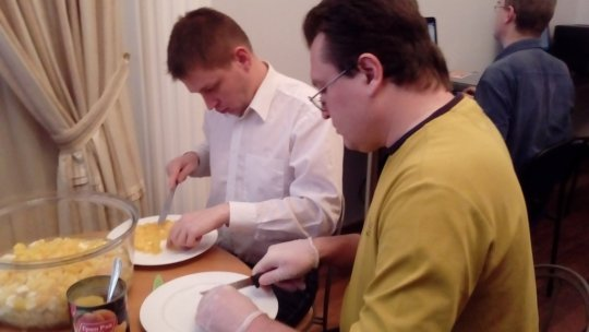 Mikhail and George  prepare food for lunch