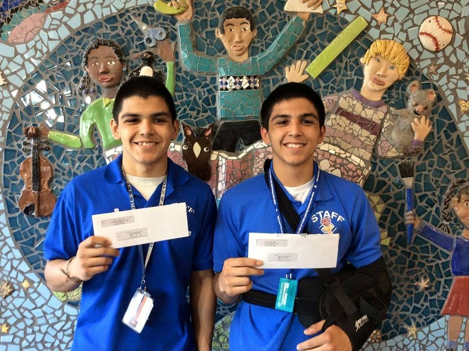 Twins Brian & Brandon receive their first paycheck