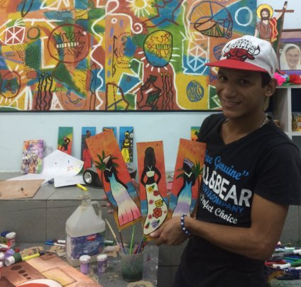 Hanthonyz at the art workshop with his paintings