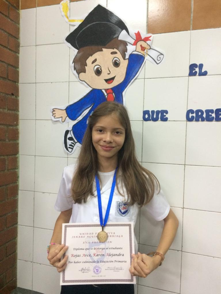 Karen with graduation diploma and medal, July 2017