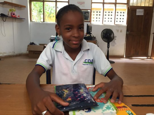 Geraldine with her school supplies