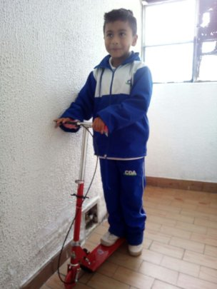Juan Pablo with his new scooter