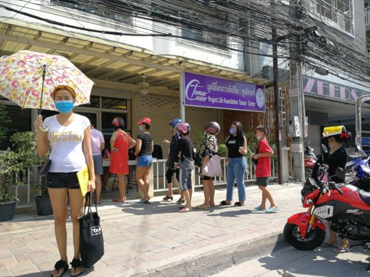 Women waiting for food at Tamar Center