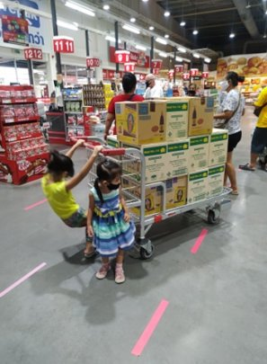 Our kids helping us shopping for food donations