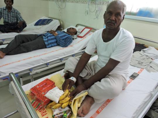 Senior citizen Patient in hospital getting milk