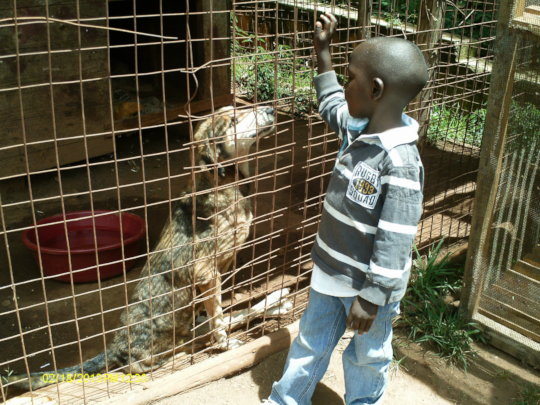 Alex Ochieng's son with Hope-2013