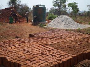Molding of bricks in progress