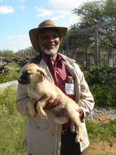 Namibian farmer with pup
