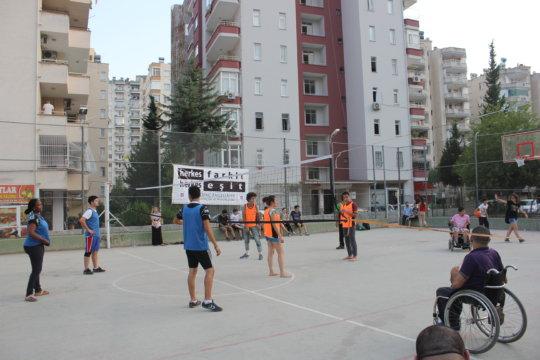 Refugee and Turkish children playing volleyball
