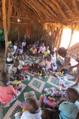 Youngest Students with Foam Blocks on Dirt Floor