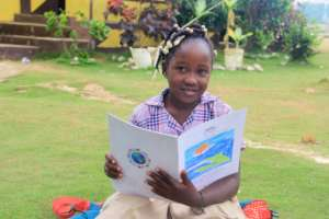 Loudia is free, safe, & enrolled in a good school.