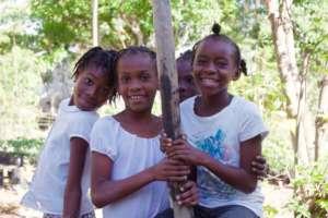 Fourth graders Nadia, Ruth, and Clarancia.