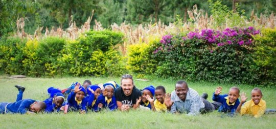 students with Gasper Mbise and visiting volunteer