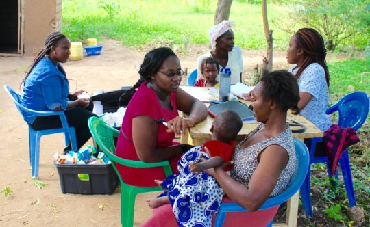Nurses assisting Mothers with Children at MCH
