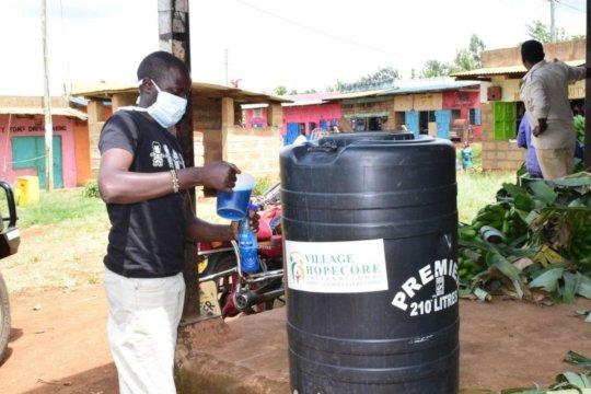 HopeCore staff distributing soap to a market