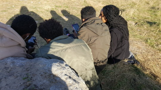 Conducting interviews with youth in Calais