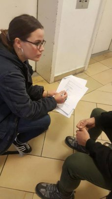 Field researcher conducting interview