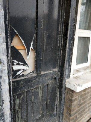 Broken door in a UK accommodation centre