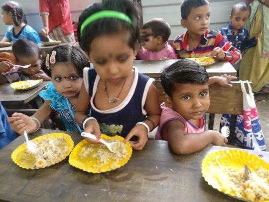 Tiny-tots enjoying sumptuous Bday meal