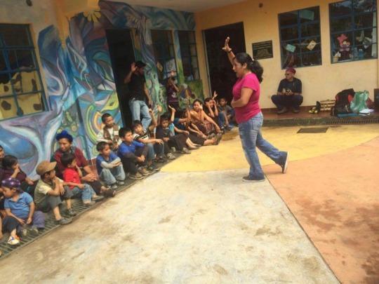 Hilda facilitating a health training in San Juan