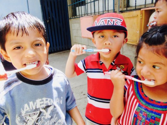 Brushing our teeth with homemade toothpaste!