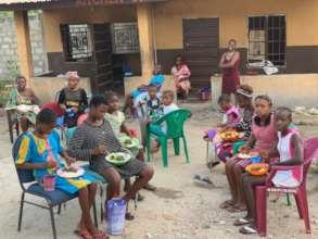 Kids eating at shelter.