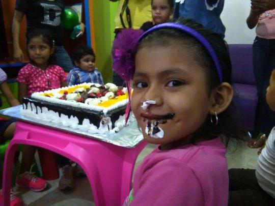 Kim eating cake