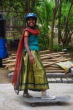 Raji Lakshmi learning how to skateboard
